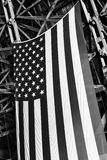 American flag hanging in an old blimp hanger. American flag hanging in an old vintage World War Two wooden blimp hanger royalty free stock photography