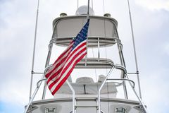 American flag hanging from the yacht. stock images