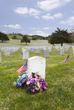 American Flag and Headstones at United States National Cemetery. Headstones, floral arrangement, and American Flags at National Military Cemetery stock photography