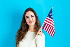 american flag holding woman young στοκ φωτογραφία με δικαίωμα ελεύθερης χρήσης