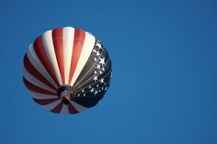 American flag hot air balloon. Scenic view of hot air balloon decorated in American flag in flight with blue sky and copy space background Royalty Free Stock Photography
