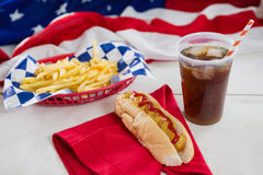 American flag and hot dog on wooden table Royalty Free Stock Photo