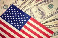 American flag on hundred dollar bill background. Money, cash background. Financial concept. Vintage, retro look. royalty free stock image