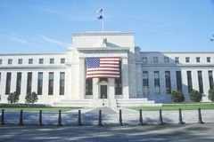 American Flag hung on The Federal Reserve Bank, Washington, D.C. stock images