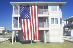 American Flag Hung on a two-story House, Pensacola, Florida Stock Image