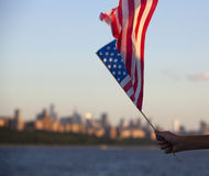 American flag during Independence Day on the Hudson River with a view at Manhattan - New York City - United States. American flag during Independence Day on the Royalty Free Stock Image