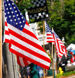 American Flag July 4th Street Celebration. Colorful American flags decorated a main street in Smalltown U.S.A. for parades and celebrations of holiday's such as stock image