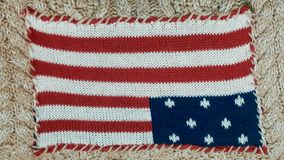 American flag. Knitted American flag on a beige background Royalty Free Stock Image