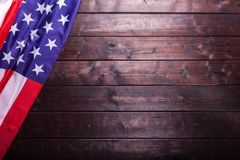 The American Flag Laying on a Wooden Background. The American Flag Laying on a Rich Old Wooden Background Stock Photography