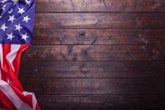 The American Flag Laying on a Wooden Background. The American Flag Laying on a Rich Old Wooden Background Royalty Free Stock Photography