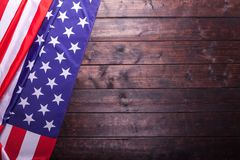 The American Flag Laying on a Wooden Background. The American Flag Laying on a Rich Old Wooden Background Stock Images
