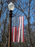 American flag and light post. Northern California small town American flag and street light Stock Photography
