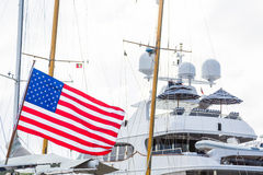 American Flag by Luxury Yacht Stock Photography