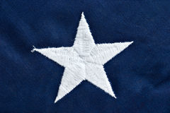 American flag macro. Close up of a star on an American flag Royalty Free Stock Photos