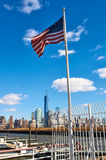 American flag with Manhattan skyline at background Stock Photos