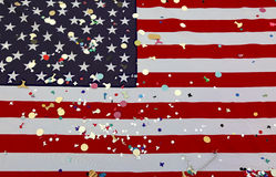 American flag with many colorful confetti during the American ho Stock Image