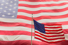 American flag on the mast. The background is made up of a large American flag Royalty Free Stock Photo