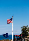 American Flag on Mast by the Sea Royalty Free Stock Images