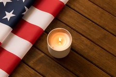 American flag and memorial candle on independence day . On wooden background royalty free stock photo