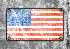 American flag on metal plate screwed screws on wall Stock Image
