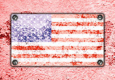 American flag on metal plate screwed screws on wall Royalty Free Stock Images