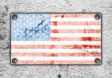 American flag on metal plate screwed screws on wall Royalty Free Stock Photos