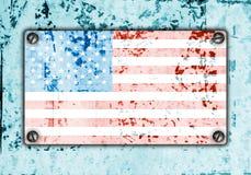 American flag on metal plate screwed screws on wall Royalty Free Stock Image