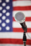 American Flag and microphone. Microphone in front of American Flag Royalty Free Stock Photo