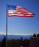 The american flag in the mountains. Picture of the American flag waving Royalty Free Stock Images