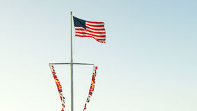 American Flag and Nautical Flags on Ship's Mast Royalty Free Stock Photo