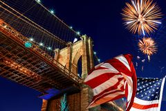 American flag and night with night Brooklyn Bridge. American flag at night with night Brooklyn Bridge in New York City Manhattan NYC, independence, day stock image
