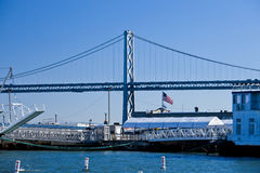 American flag and Oakland bridge, san francisco, california, united states. Pier seven, oakland bridge, san francisco, california, united states stock photos