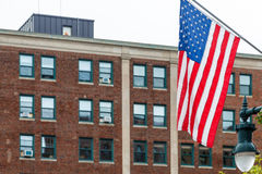 American Flag with Old Brick Building in Background Royalty Free Stock Photos