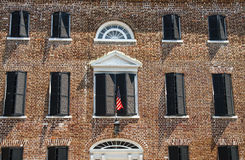 American Flag on Old Brick Building Stock Image