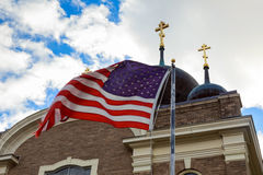 American flag and old church steeple reflect separation of state Stock Photography