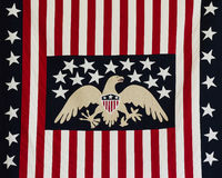 American flag. Old vintage American flag with eagle in the center Stock Image