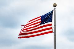 Free American Flag On A Cloudy Sky Background; Close Up For Memorial Day Or 4th Of July Royalty Free Stock Photography - 147807017