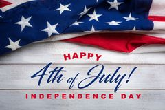 Free American Flag On A White Worn Wooden Background With July 4th Greeting Royalty Free Stock Images - 120255369