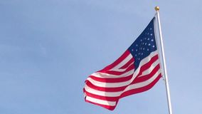 American flag over clear sky stock footage