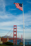 American flag over Golden Gate Bridge Stock Images