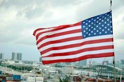 American flag over the port of Miami, Florida stock photos