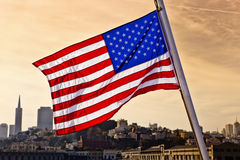 American Flag over San Francisco. An American flag waves over a San Francisco skyline Stock Images