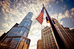 American flag over skyscrapers royalty free stock image