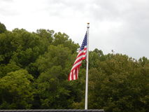 An American Flag Overlooking great Smokey Mountains Stock Images