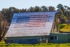 American Flag Painted On Old Tin Roof Of Barn royalty free stock image