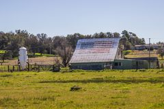 American Flag On Roof Of Barn stock images