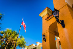 American Flag with palm trees and a building in Vilano Beach, Fl Royalty Free Stock Photography
