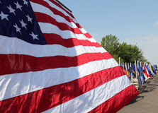 American Flag on Parade. An American flag flies while in a parade royalty free stock photos