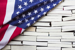 American flag and piles of books Stock Images