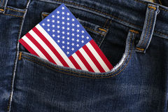 American flag in a pocket of blue jeans. Close up Royalty Free Stock Images